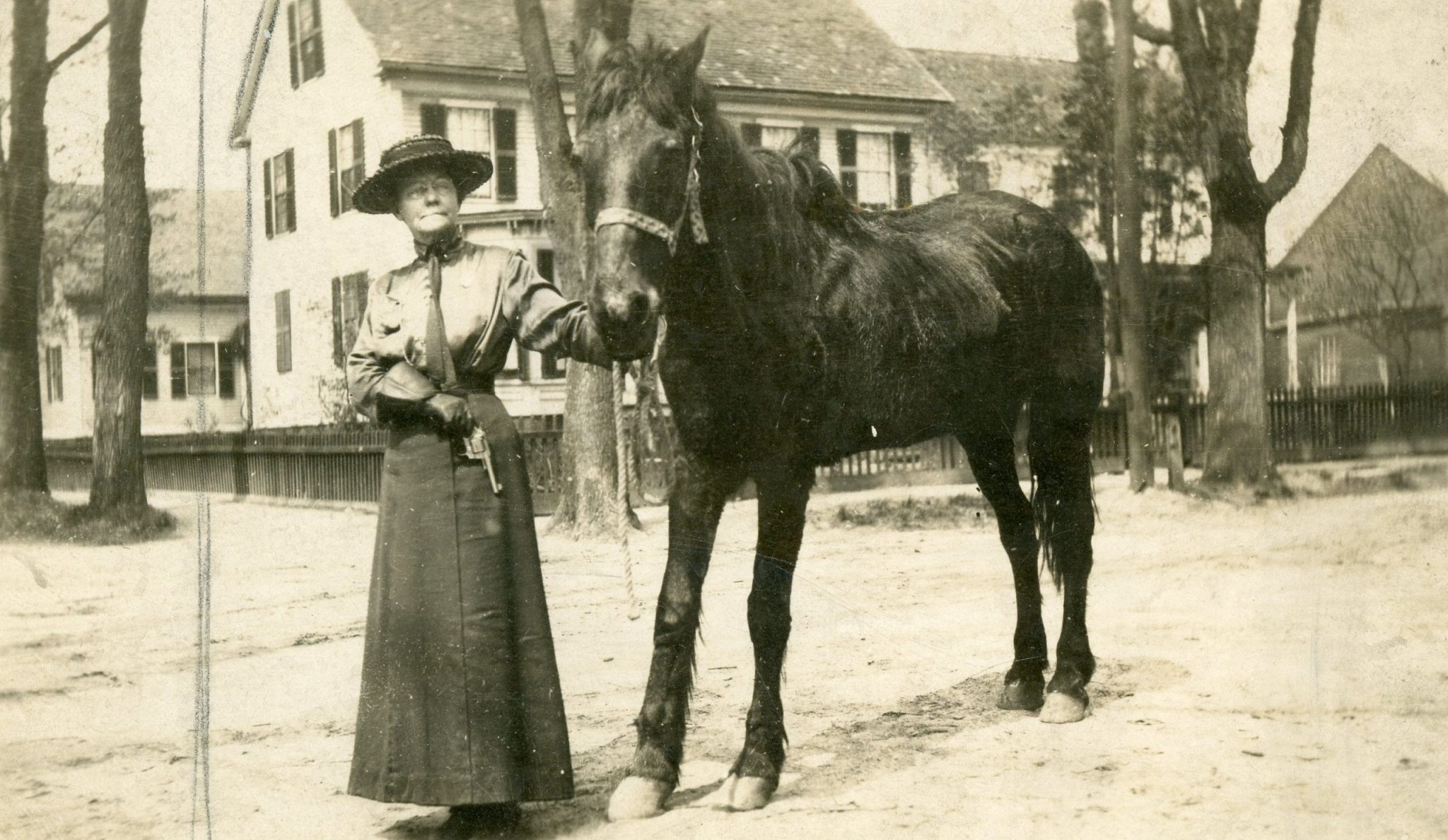 Jennie Powers black and white photo next to a horse.